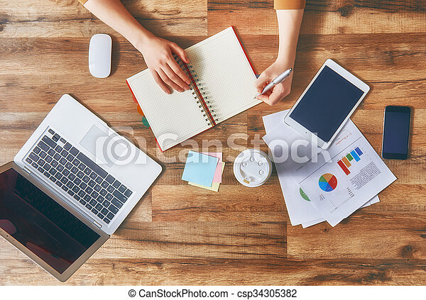 woman making notes - csp34305382