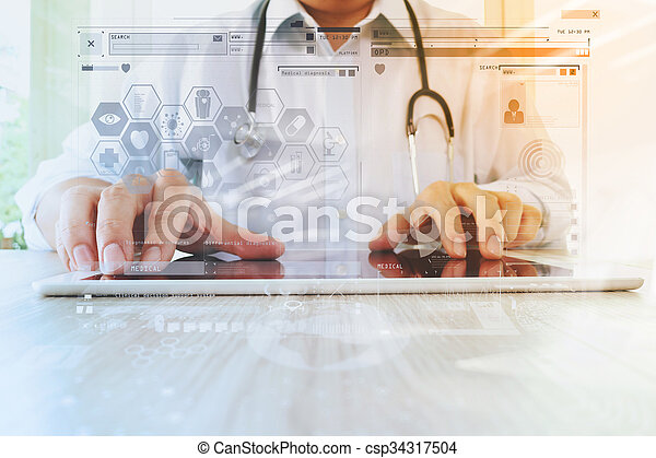 Medicine doctor hand working with modern digital tablet with computer interface as medical network concept