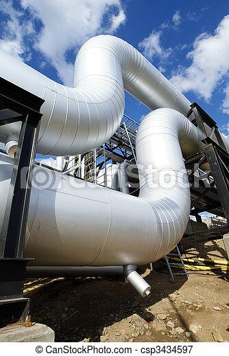 industrial pipelines on pipe-bridge against blue sky - csp3434597