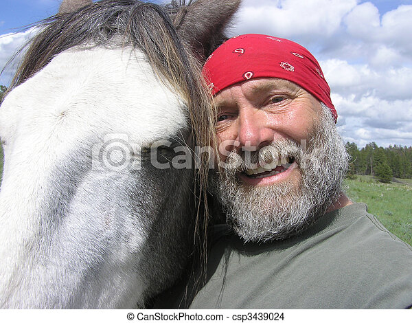 Owner being silly with horse - csp3439024