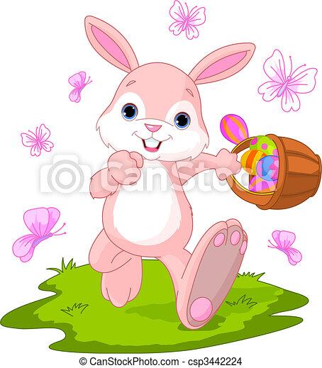 Easter Bunny Hiding Eggs - csp3442224