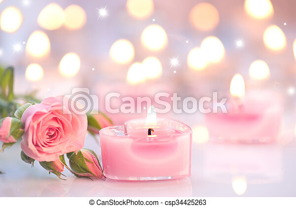 Valentine\'s day. Pink heart shaped candles and rose flowers