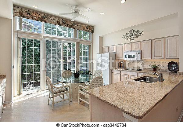 Kitchen with sliding doors to patio - csp3442734