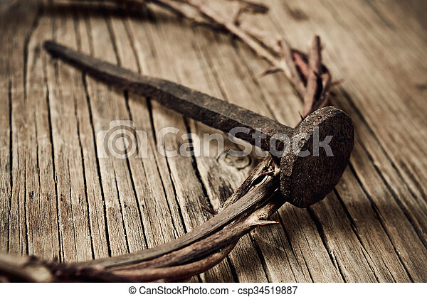 a depiction of the crown of thorns of Jesus Christ and a nail, on the Holy Cross