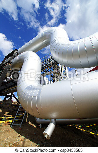 industrial pipelines on pipe-bridge against blue sky - csp3453565