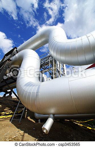 industrial pipelines on pipe-bridge against blue sky - csp3453565