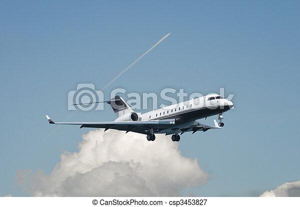 Large double engine business jet landing - csp3453827