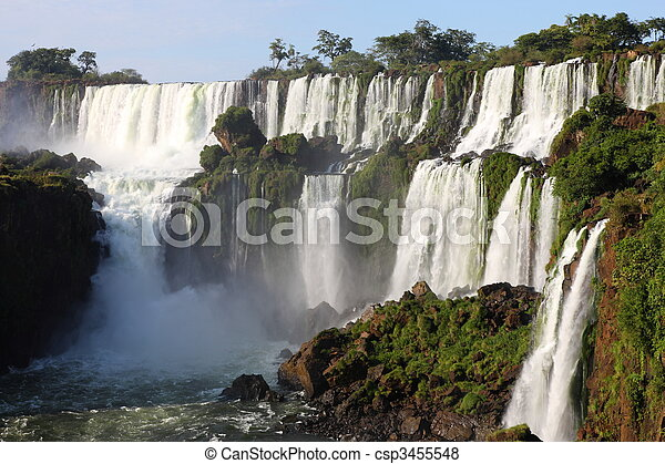 Iguassu waterfalls on a sunny day early in the morning. The biggest waterfalls on earth. - csp3455548