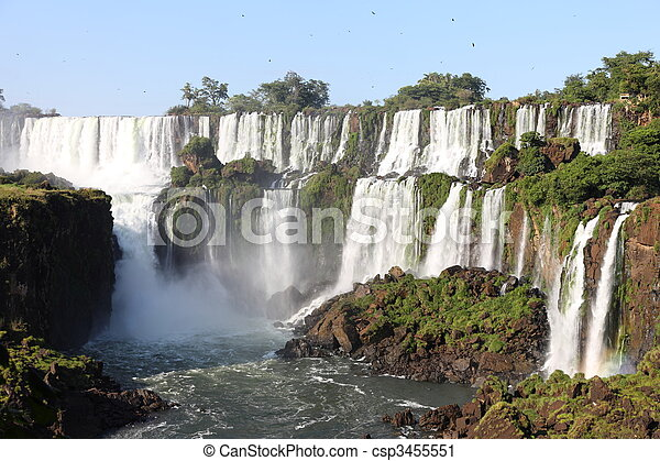 Iguassu waterfalls on a sunny day early in the morning. The biggest waterfalls on earth. - csp3455551