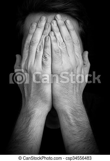 Depression concept – man covering face with hands