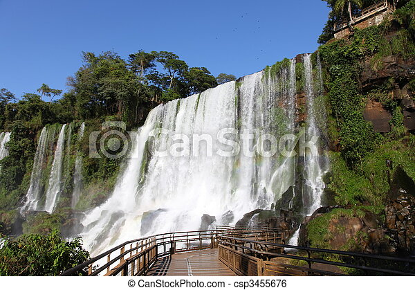 Iguassu waterfalls on a sunny day early in the morning. The biggest waterfalls on earth. - csp3455676
