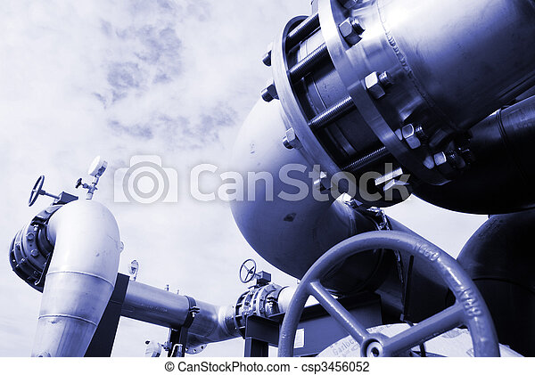 Pipes, bolts, valves against blue sky in blue tones - csp3456052
