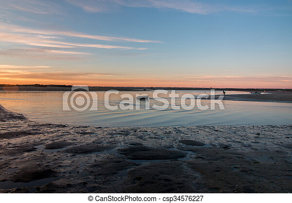 Wide view of sunrise horizon line on a beach