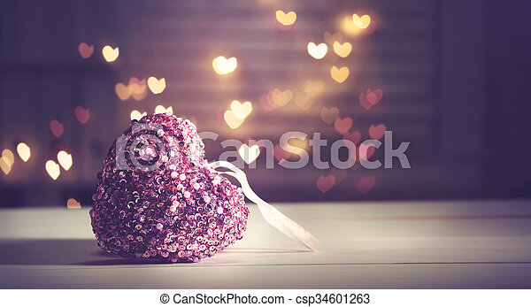 Pink heart on heart shaped abstract light background