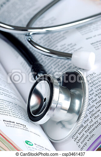 A stethoscope on the top of a medical reference book - csp3461437