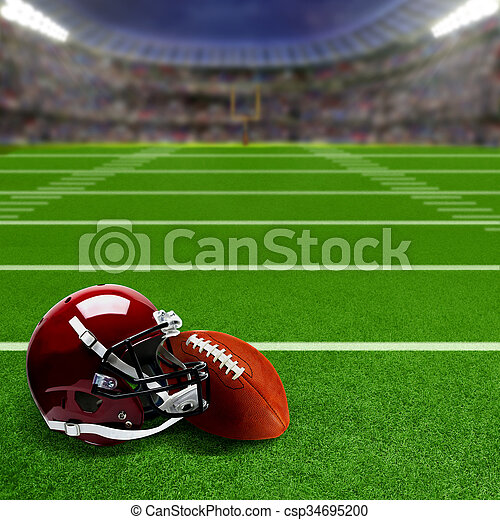 American football stadium full of fans in the stands with football helmet and ball on the field. Deliberate focus on equipment and foreground with shallow depth of field on background. Floodlights flare for effect and copy space.