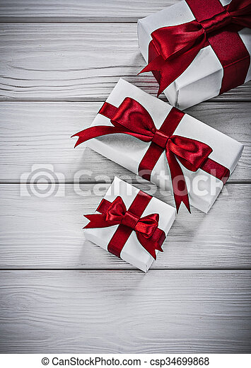 Packed present boxes on wooden board holidays concept.