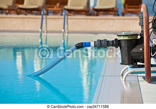pictures of cleaning pump working with a swimming pool horizontal shot csp34711588 search. Black Bedroom Furniture Sets. Home Design Ideas