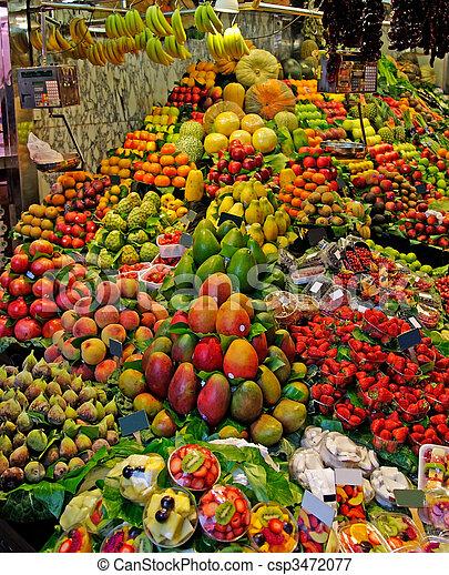 La Boqueria fruits stall. World famous Barcelona market, Spain. - csp3472077