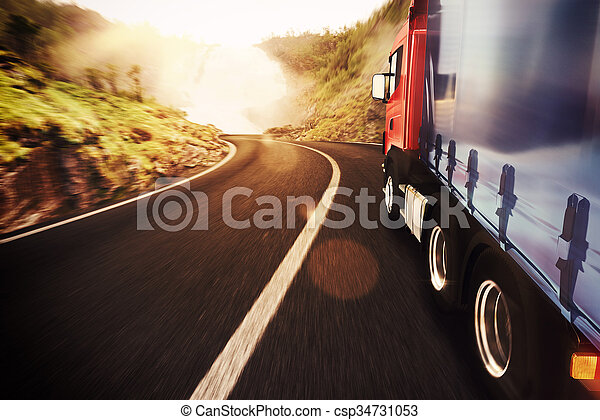 Truck on road in a natural landscape