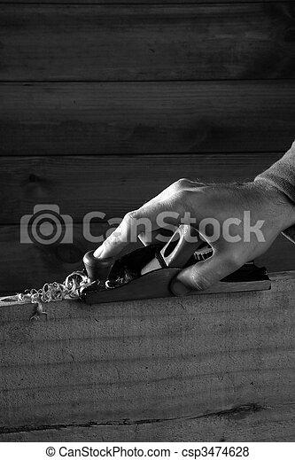 carpenter planning wood planer tool man hand - csp3474628