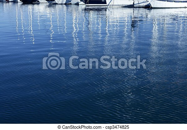 Sailboat blurred mast reflexion on the marina - csp3474825