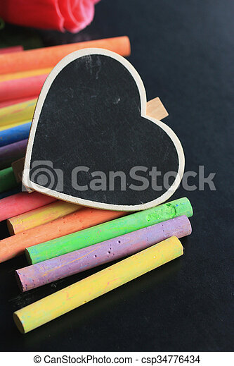 Colorful chalk with black heart