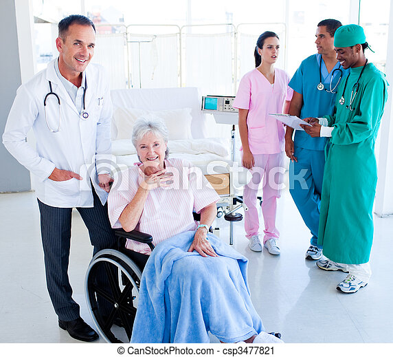 Positive medical team taking care of a senior woman - csp3477821