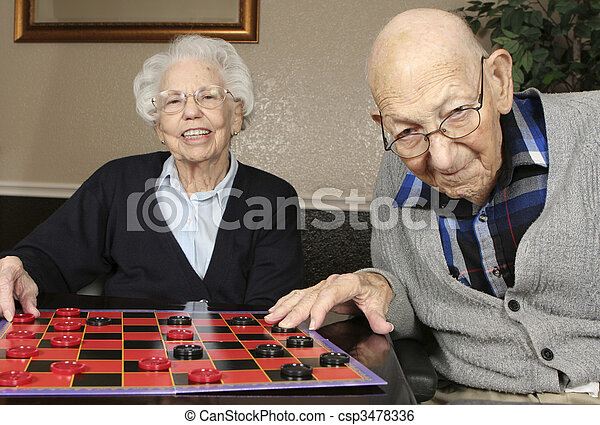 Active Seniors Playing Checkers - csp3478336