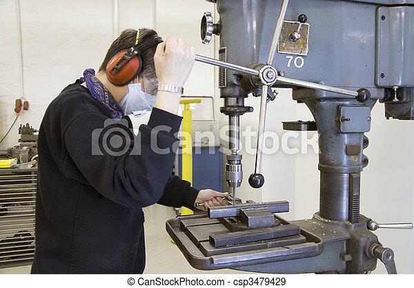 drilling machine and worker - csp3479429