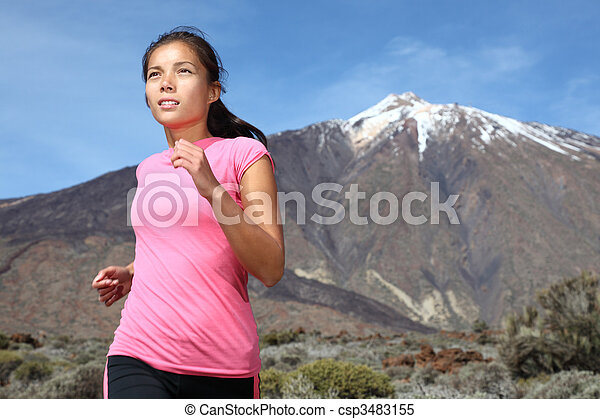 Woman running on mountain trail - csp3483155