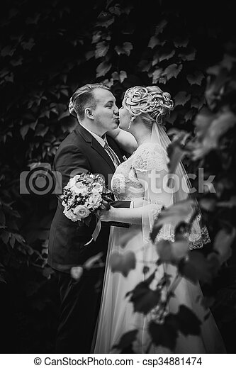 Black white photography beautiful young couple stand on background forest