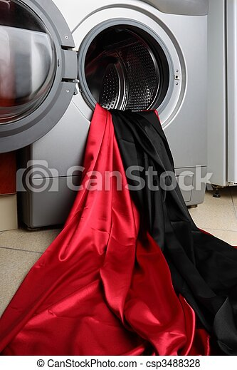 Smooth red and black satin fabric in a washing machine - csp3488328