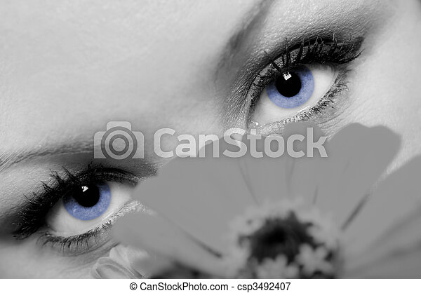 A concept photo closeup of a lovely woman with beautiful blue eyes. - csp3492407