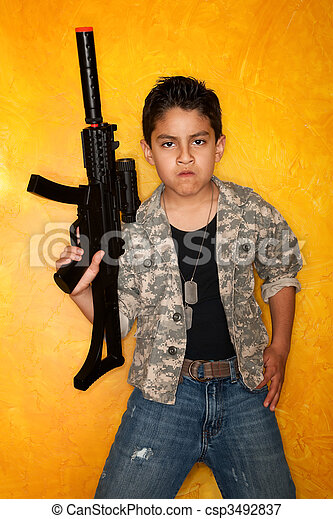 Hispanic Boy with Toy Gun - csp3492837