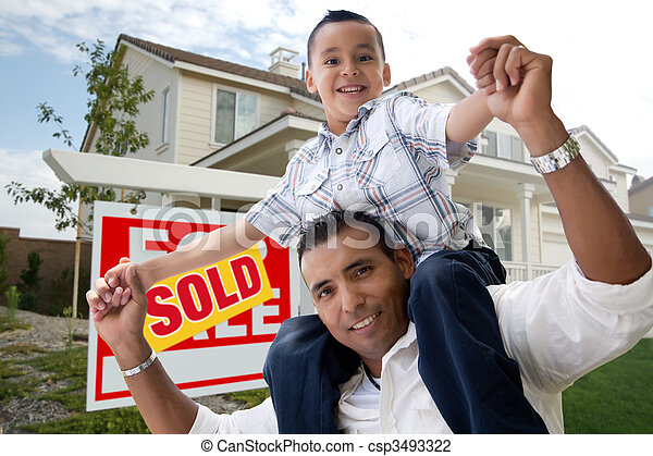 Hispanic Father and Son in Front of Their New Home - csp3493322
