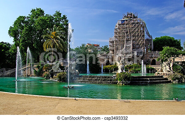 Ciutadell park in centre of Barcelona. Fountain and reconstruction of building. Spain.