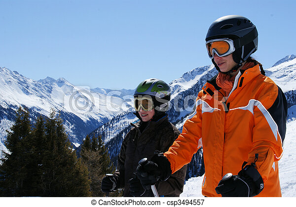 A woman and a child about a super ski with skis down to go. - csp3494557
