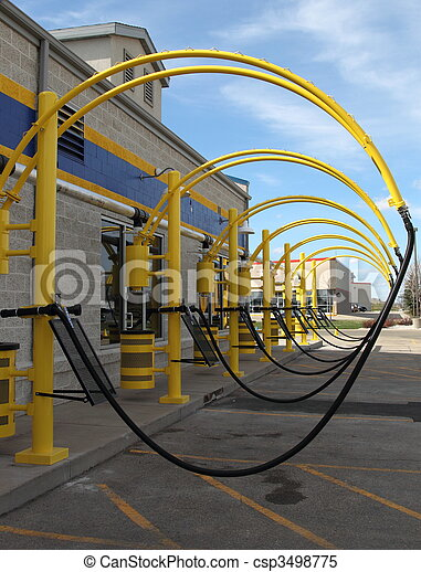 Vacuum hoses in a row at a car wash. - csp3498775