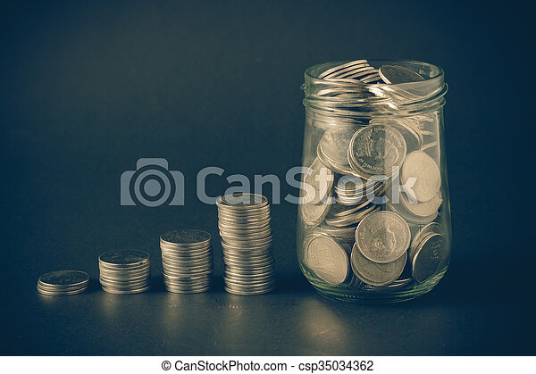 Money coin stack growing graph with filter effect retro vintage style