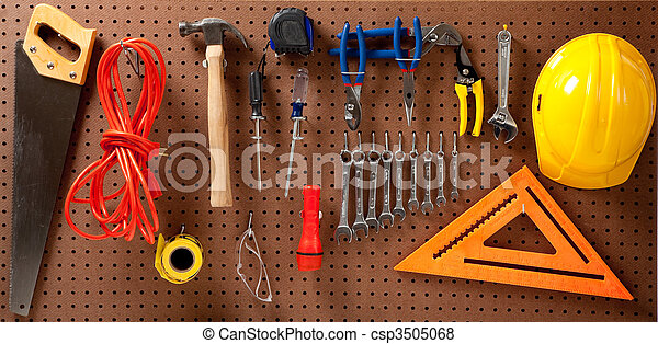 Peg board with tools and hard hat - csp3505068