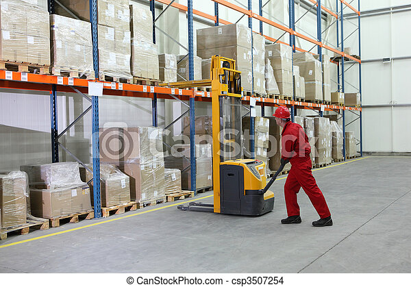 manual forklift operator at work in warehouse - csp3507254