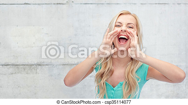 emotions, expressions and people concept - young woman or teenage girl shouting over gray concrete wall background