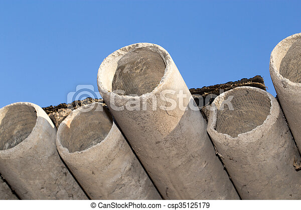 asbestos cement pipes against the blue sky - csp35125179