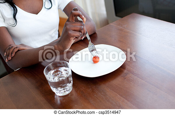 Teen girl eating a tomato - csp3514947