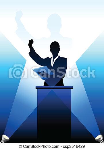 Business/political speaker silhouette behind a podium  - csp3516429