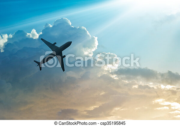 Airplane in the sky and cloud at sunrise