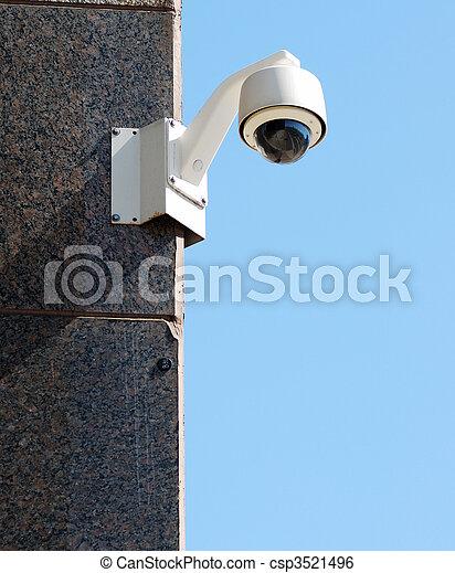 Security / surveillance camera against a clear blue sky - csp3521496