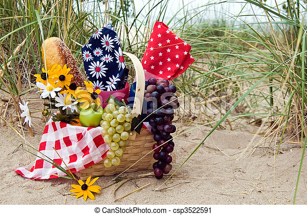 Picnic basket in a sand dune setting.