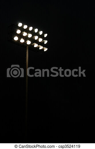 Stadium lights on a sports field at night with copy space - csp3524119